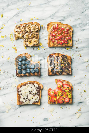 Healthy breakfast or snack with wholegrain toasts, top view - Stock Photo