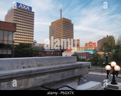 Syracuse, New York, USA. July 1, 2018. View of The AXA Towers, once known as The Mony Towers, off Columbus Circle in downtown Syracuse, New York - Stock Photo