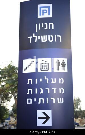 Information panel written in Hebrew. Parking and toilets. Tel Aviv. Israel. - Stock Photo