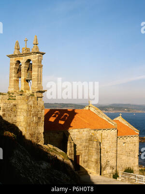 Spain. Galicia. Province of La Coruña. Muxia. Parish Church of Santa Maria of Muxia. It was built in the 14 century in Gothic sailor style over an earlier temple of the 12th century. - Stock Photo