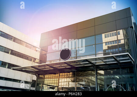 Blank black round signage mockup, modern business building. Circle sign board mock up hanging on glass roof of the store endrance. Street advertising banner design template. - Stock Photo