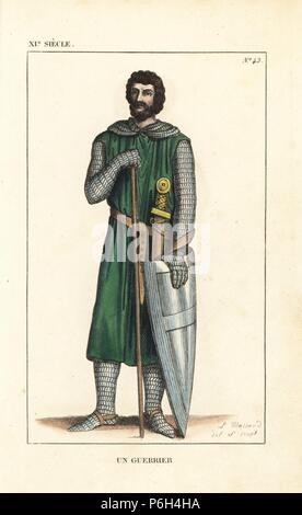 French soldier, 11th century. He wears a simple tunic over a chainmail suit with hood, and is armed with sword, baton, and buckler (shield). Handcoloured copperplate drawn and engraved by Leopold Massard from 'French Costumes from King Clovis to Our Days,' Massard, Mifliez, Paris, 1834. - Stock Photo