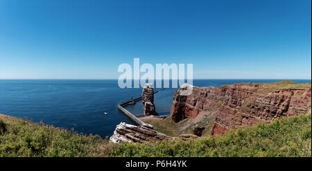 Lange Anna sea stack rock on Heligoland island against blue sea and clear sky - Stock Photo