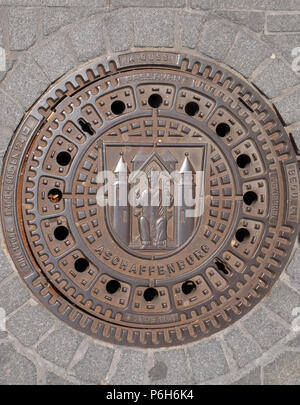 Coat of Arms of Aschaffenburg on the manhole cover in Aschaffenburg, Germany - Stock Photo