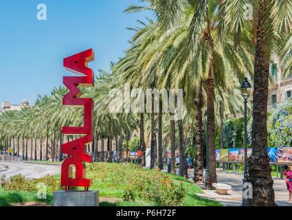 30 July 2017 - Palma de Majorca, Spain. Beautiful capital and the largest city of the Balearic islands. Red Palma sign and Palma trees in the background - Stock Photo
