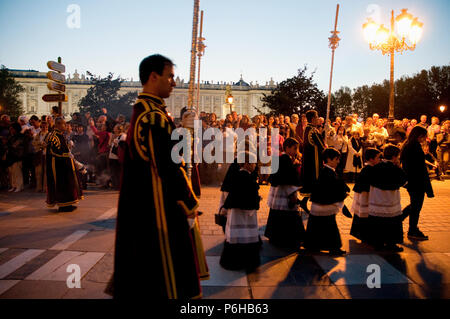 People during a Holy Week procession. Plaza de Oriente, Madrid, Spain. - Stock Photo