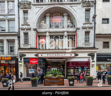 Exterior and entrance to Piccadilly shopping arcade, (formerly a cinema) Stegosaurus planter, New St, Birmingham, England, UK - Stock Photo