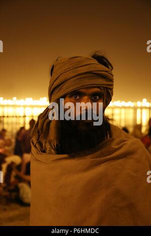 Portrait of sadhu baba in the crowd during Maha Kumbh mela 2013 in Allahabad , India - Stock Photo