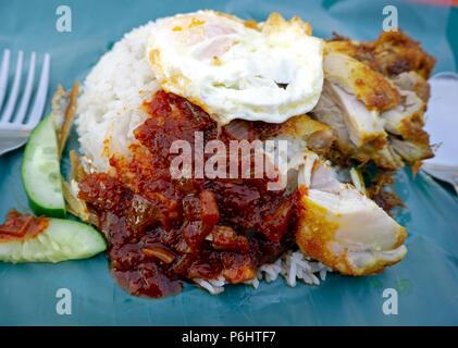 Nasi lemak or coconut milk rice, popular dish in Malaysia. - Stock Photo