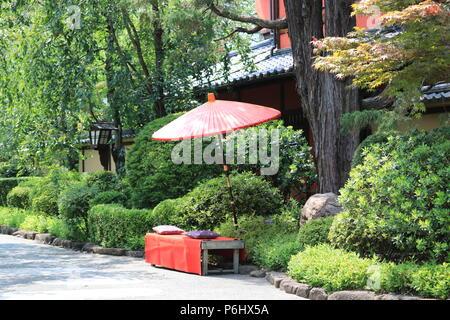 Japanese Umbrella (Wagasa) in a Street - Stock Photo