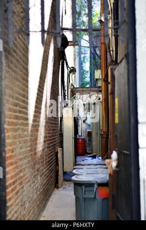 New York alleyway with trash cans between buildings