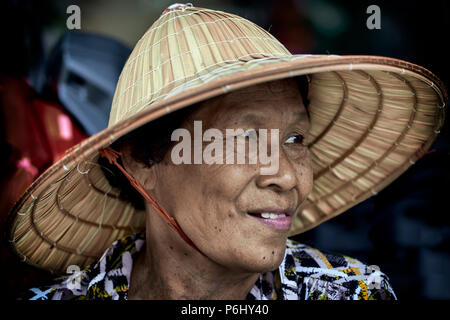 portrait of a Thai woman wearing Vietnamese conical hat, Asian rice hat. Thailand Southeast Asia - Stock Photo