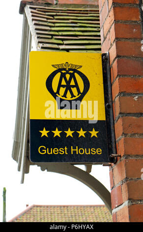 An old AA five-star Guest House sign outside a property on the A149 coast road at Cley-Next-the-Sea, Norfolk, England, United Kingdom, Europe. - Stock Photo