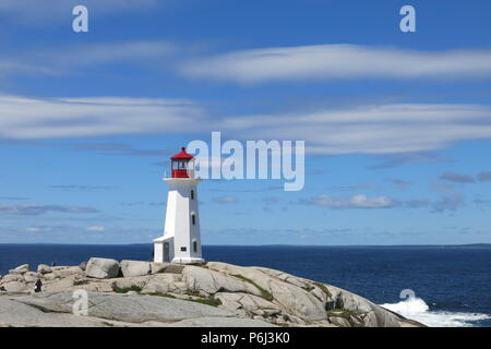 The red and white lighthouse on an outcrop of granite boulders at Peggys Cove, Nova Scotia, Canada - Stock Photo