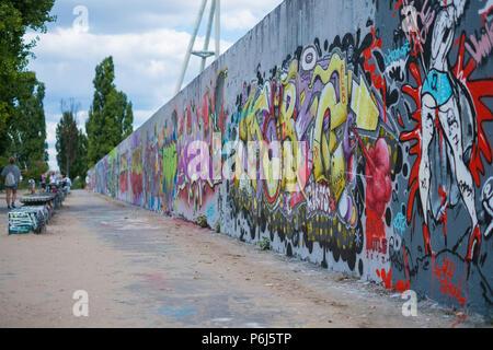 Berlin, Germany - june 2018: Graffiti wall at Berlin Mauerpark, former boder between east and west Berlin - Stock Photo