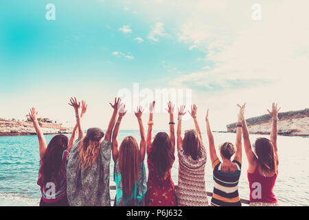 group of women enjoying and celebrate summer vacation all together saying hallo to the ocean and the nature. young people leisure activity, all hands  - Stock Photo