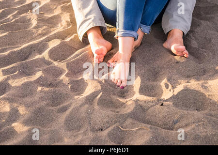 hugged feet in a summer sunny day at the beach for vacation or leisure activity together in couple. love and relationship concept with man and woman t - Stock Photo