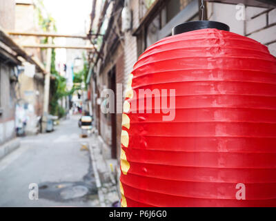 Chinese red lantern hanging in front of old houses in the French concession in the city center of Tianjin - Stock Photo