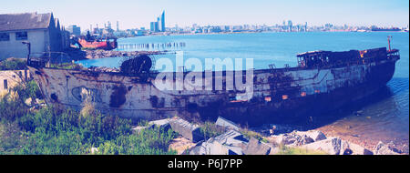 View of different parts of port zone of Montevideo. Contrast of modern and old destroyed parts, Montevideo, Uruguay - Stock Photo