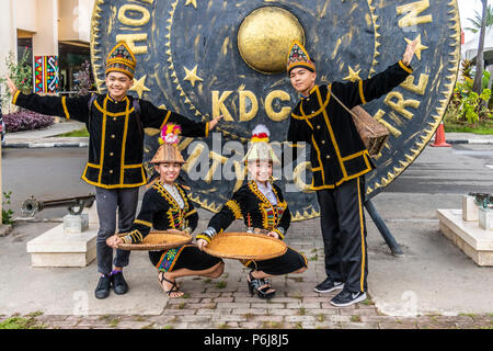 Young people in traditional costume at KDCA building in Kota Kinabalu Sabah Malaysia Borneo taking part in 2017 Harvest Festival events. - Stock Photo