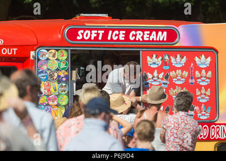 The hot weather at a Concert in the Park in Sutton Park near Birmingham. The queue for the ice cream van. - Stock Photo