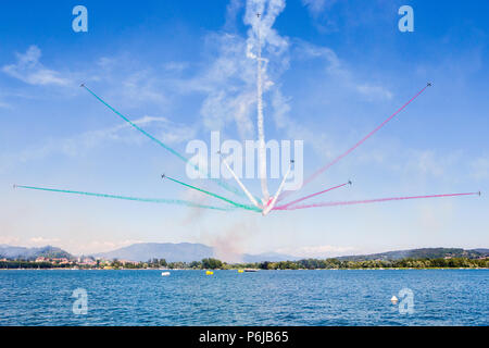 Arona Italy. 30 June 2018. The FRECCE TRICOLORI officially known as the 313° Gruppo Addestramento Acrobatico of the Italian Aeronautica Militare in their demonstration of acrobatic flight on the lakefront of Arona. - Stock Photo