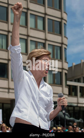 Boston, Massachusetts, USA. 30th June, 2018.  U.S. Senator Elizabeth Warren (Democrat Massachusetts) raises her fist as she spoke to thousands from the back of a truck at Boston City Hall during the Rally against Family Separation in Boston, MA. Demonstrations against U.S. President Donald Trump's immigration policy of detaining central American and Mexican immigrants and the separation of immigrant families.  Large rallies against President Trump's policy of separating migrant families took place in more than 750 U.S. cities on June 30th of 2018. Chuck Nacke / Alamy Live News - Stock Photo