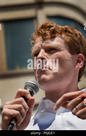U.S. Democratic Representative Joseph Patrick Kennedy III (Joe Kennedy), grandson of Robert Kennedy and grand-nephew of John F. Kennedy speaking at Boston City Hall during the Rally against Family Separation in Boston, MA. Kennedy spoke against U.S. President Donald Trump's policy of detaining immigrants and separating immigrant families.  Large rallies against President Trump's policy of separating immigrant families took place in more than 750 U.S. cities on June 30th of 2018. Chuck Nacke / Alamy Live News - Stock Photo