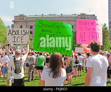 Cleveland, USA.  30th June, 2018.  Cleveland area residents protest in opposition to the Trump policies separating children from parents at the border.  Signs are held high showing a mix of anger, embarassment, and sadness.  Hundreds gathered on Public Square in downtown Cleveland, Ohio for hours to rally against perceived injustices of the government. Credit: Mark Kanning/Alamy Live News - Stock Photo