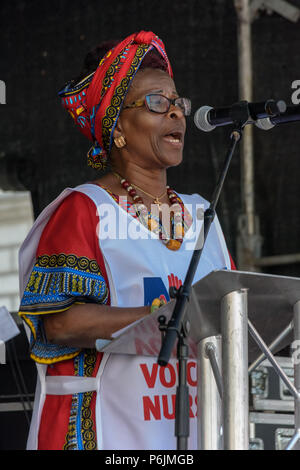 June 30, 2018 - London, UK. 30th June 2018. Royal College of Nursing (RCN) President Cecilia Anim speaks at the rally near Downing St to celebrate 70 years of the NHS, and to support its dedicated workers in demanding a publicly owned NHS that is free for all with proper funding and proper staffing and providing a world class services for every community. The protest, organised by the the People's Assembly, Health Campaigns Together, Trades Union Congress, Unison, Unite, GMB, British Medical Association, Royal College of Nursing, Royal College of Midwives, CSP, BDA, and SoR was to defend the - Stock Photo
