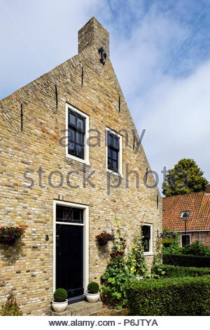 A brick house in the village at Vesting Bourtange, the star-shaped fortress in Groningen Province, The Netherlands - Stock Photo