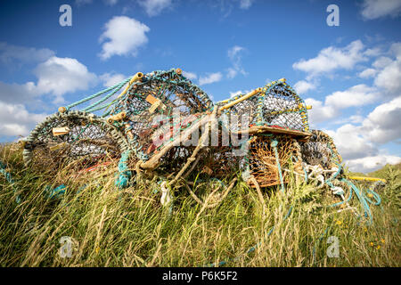 Stack of lobster pots on harbour side - Stock Photo