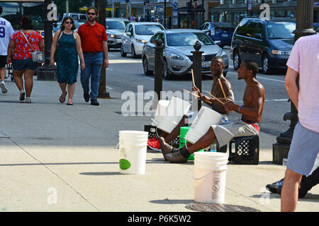 The iconic 'Bucket Boys' play for tips from the tourists in Michigan Avenue outside of the Art Institute of Chicago - Stock Photo