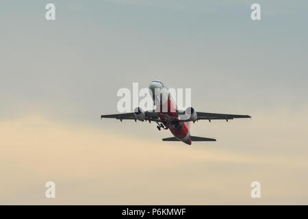 Phuket, Thailand - Apr 23, 2018. An Airbus A320 airplane of AirAsia taking-off from Phuket International Airport (HKT). - Stock Photo