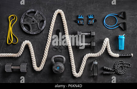 Sports equipment on a black background. Top view. Motivation - Stock Photo