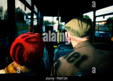 photograph of the backss of heads of an elderly couple on a local bus in Newcastle - Stock Photo