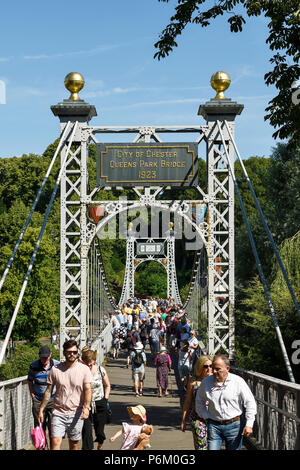 The Queens Park suspension bridge over the River Dee at The Groves in Chester UK - Stock Photo