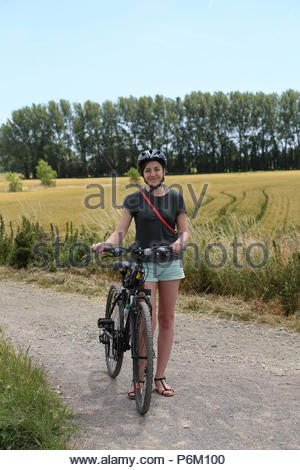 Female cyclist exploring the South Downs National Park on a summer day, United Kingdom - Stock Photo