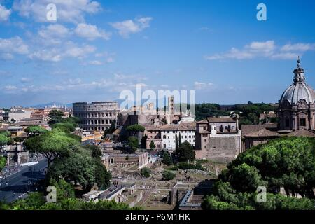 ROME, ITALY - 29 JUNE 2018: View of the Colosseum and the Fori Imperiali, monuments visited every year by millions of tourists from all over the world - Stock Photo