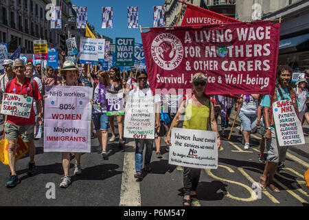 London, UK. 30th Jun, 2018. Global women's strike banner on Regent Street. With the NHS 70 years old this year, thousands marched through central London in a National rally to show support for the service and to demand more funding from the Government. David Rowe/Alamy Live News - Stock Photo