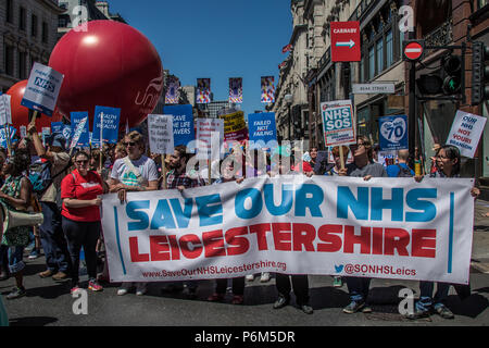London, UK. 30th Jun, 2018. Leicestershire 'Save our NHS' banner on Regent Street. With the NHS 70 years old this year, thousands marched through central London in a National rally to show support for the service and to demand more funding from the Government. David Rowe/Alamy Live News - Stock Photo