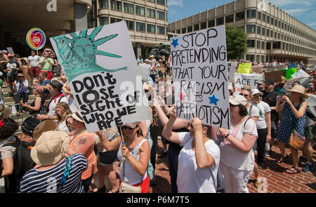 Boston, Massachusetts, USA. 30th June, 2018.  U.S. Demonstrators holding a signs in City Hall Plaza in Boston, MA during the Rally against Family Separation by the current United States administration. Rallies against U.S. President Donald Trump's policy of the detention of Central American and Mexican immigrants and immigrant families separated by U.S. customs and border agents (I.C.E.) took place all over the United States.  Credit: Chuck Nacke/Alamy Live News - Stock Photo