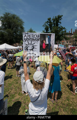Boston, Massachusetts, USA. 30th June, 2018.  U.S. Demonstrator holding a sign as thousands gathered in the Boston Common in Boston, MA during the Rally against Family Separation by the current United States administration. Rallies against U.S. President Donald Trump's policy of the detention of immigrants and immigrant families separated by U.S. customs and border agents (I.C.E.) took place in more than 750 US cities on June 30th. Credit: Chuck Nacke/Alamy Live News - Stock Photo