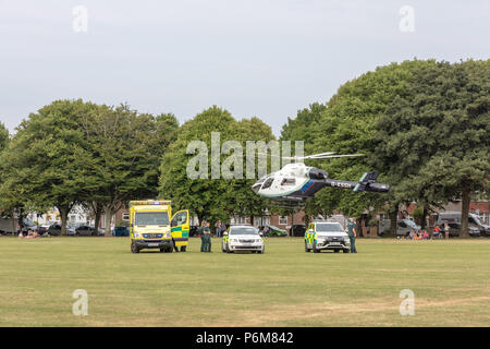 Worthing, Sussex, UK. 1st Jul, 2018. Air Ambulance lifts off from Victoria Park with a casualty who had been transferred from an ambulance that had arrived in the park by road.  Credit: Ian Stewart/Alamy Live News - Stock Photo