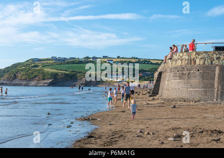Broad Haven, Wales, UK. 30th June 2018. People enjoy the last of the June heatwave on the beach at Broad Haven and Littlehaven in South Wales. Credit Thomas Faull / Alamy Live News - Stock Photo