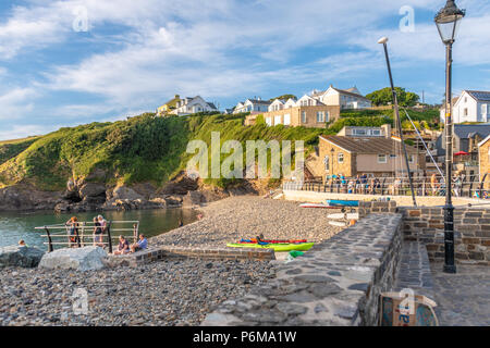 Broad Haven, Wales, UK. 30th June 2018. People enjoy the last of the June heatwave on the beach at Little Haven in South Wales. Credit Thomas Faull / Alamy Live News - Stock Photo