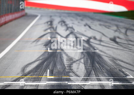 Red Bull Ring, Spielberg, Russia. 1st Jul, 2018. Tire marks are seen on the track near the start finish line prior to the Austrian Formula 1 Grand Prix race at the Red Bull Ring, in Spielberg, Austria on July 1, 2018. Credit: Jure Makovec/Alamy Live News - Stock Photo