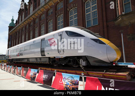 Newcastle-upon-Tyne, UK. 1st Jul, 2018. The London North Eastern Railways (LNER) logo on an Azuma locomotive in LNER livery outside of Discover Museum in Newcastle-upon-Tyne, UK. The Hitachi-built engines will come into use by the LNER franchise in 2018 and 2019. Credit: Stuart Forster/Alamy Live News - Stock Photo