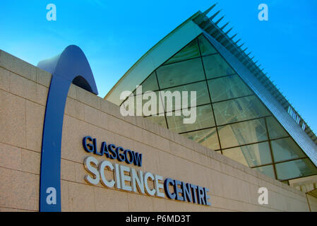 Glasgow, Scotland, UK 1st July. UK Weather:Sunny sizzling weather continues and The weather proof cover on Glasgow Science Centre's roof that melted at the start of the scorching weather, continues to drip, the black drips down the building.It look lovely in the Golden sunlight . Credit: gerard ferry/Alamy Live News - Stock Photo