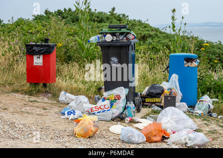 Highcliffe, UK. 1st of July 2018. As the UK heat wave continues, beaches along the South coast this weekend have seen high numbers of visitors resulting in higher than normal rubbish and litter on beaches. Pictured here are overflowing rubbish/ litter bins on Highcliffe beach, Dorset, England, UK. Katharina Brandt/ Alamy Live News - Stock Photo